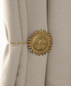 Omtagsfäste för gardinomtag, Sol mässing